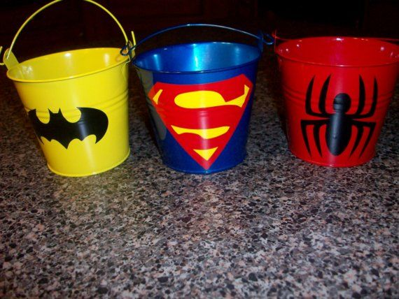 Superhero party favor buckets. I can see these being used to sort small toys, crayons & such in afterwards.