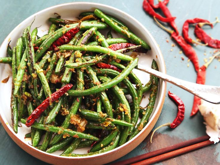 Gan bian si ji—Sichuan-style dry-fried green beans with chilies and pickles—are one of the best and most mistranslated vegetable dishes in the world. Today that dish and I are on a road trip back to authenticity, and we're going to be driving that minibus over some uncharted territory.