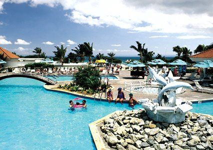 Unwind with a cool drink at the swim-up bar of Bluegreen Vacations La Cabana Beach Resort and Casino, an Ascend Resort in Oranjestad, Aruba.