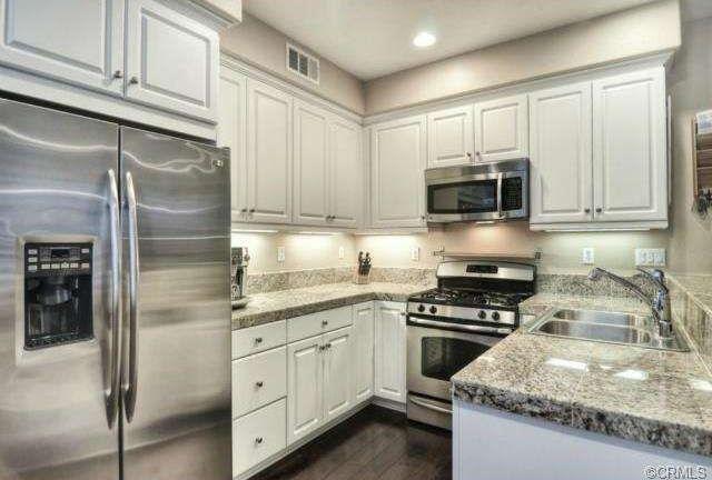 25 elegant kitchens without windows more basin sink for Kitchen designs without windows