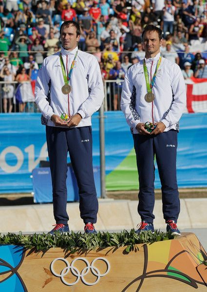Gold medalists Ladislav Skantar and Peter Skantar of Slovakia celebrate on the podium at the medal ceremony for the Men's Canoe Double (C2) on Day 6 of the Rio 2016 Olympics at Whitewater Stadium on August 11, 2016 in Rio de Janeiro, Brazil