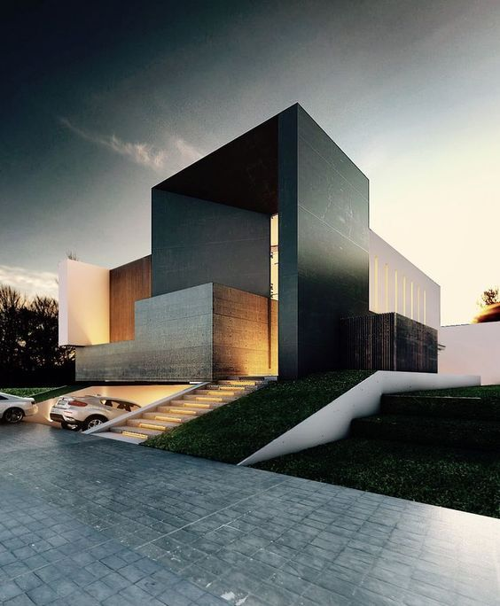 Loving the massing of this cool home. Hoping there are more windows in the back of the property. | modern architecture at its best! #pin_it #architeture @mundodascasas See more here: www.mundodascasas.com.br (scheduled via http://www.tailwindapp.com?utm_source=pinterest&utm_medium=twpin&utm_content=post10715316&utm_campaign=scheduler_attribution):