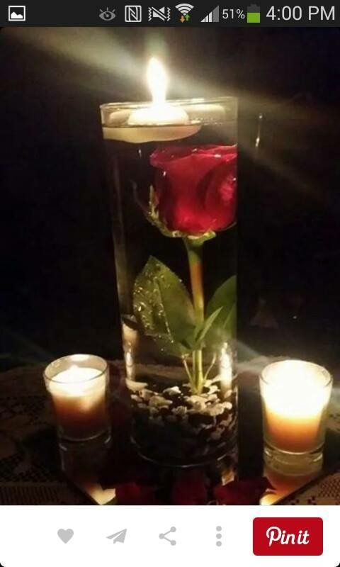 """How about this for """"Beauty and the Beast"""" wedding, but with submerged light instead of floating candle?  And in inexpensive drinking glasses from the thrift store."""