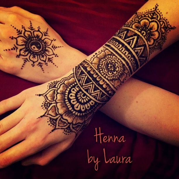 Detailed hand and wrist flower henna design and simple ying yang sun. Created by Denver henna artist.