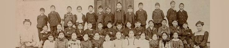 Alaskan Indian schoolchildren pose in front of school, Alaska, ca. 1903