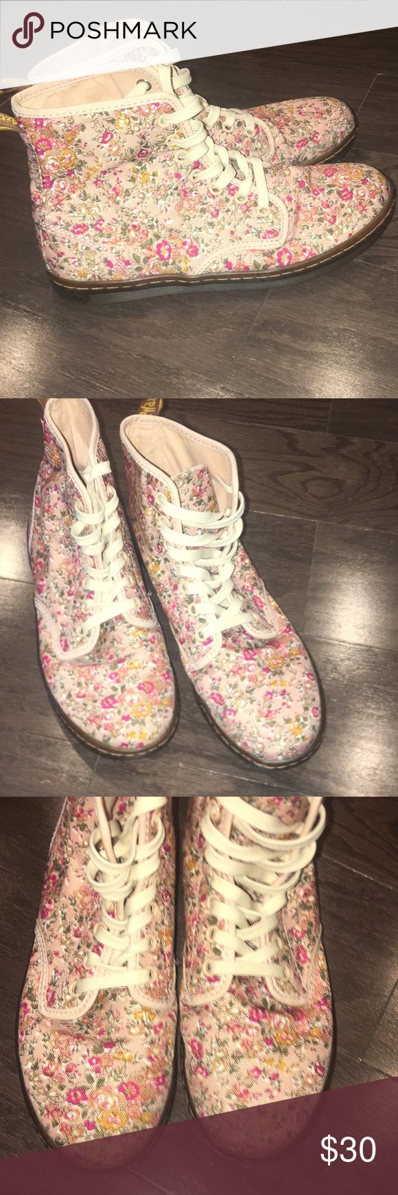 Doc Marten's Air Wair floral design Super comfy shoes!! Great for walking- very lightweight In very good condition and is a durable shoe with air cushion soles The canvas is decorated with red, yellow, and green flowers and has creme colored laces Dr. Martens Shoes Combat & Moto Boots