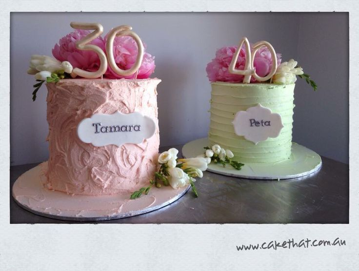 Soft iced cakes. Buttercream and fresh flowers. Pastel tones.