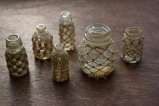 Crocheted bottle covers....wonder if we could do something similar with fishing net? @jessicawhipple