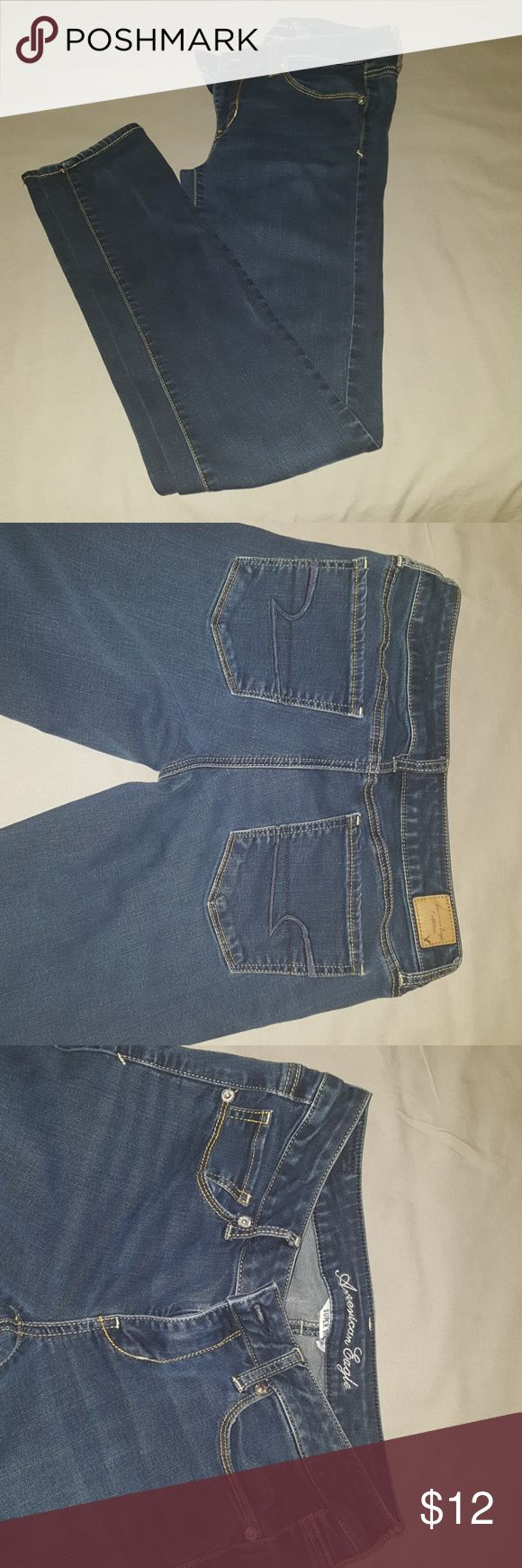 American Eagle Size 8 Long Super Stretch jeans Dark blue with gold/yellow stitching Good condition Super stretchy 28 inch waist 31 inch inseam American Eagle Outfitters Jeans Skinny