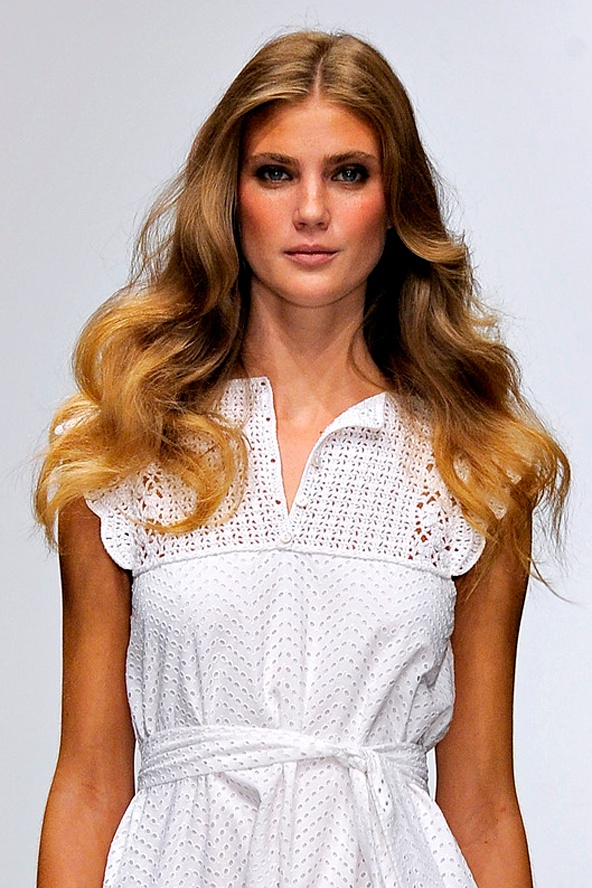 The Look: Big and bold glamorous curls brushed out to create gentle feminine waves    TOP TIP: To create this look at home, use a large curling wand to add dramatic spiral curls, then brush through to create flowing waves.