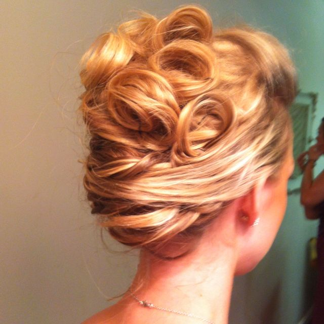 Updo: French twist/updo with less prominent curls