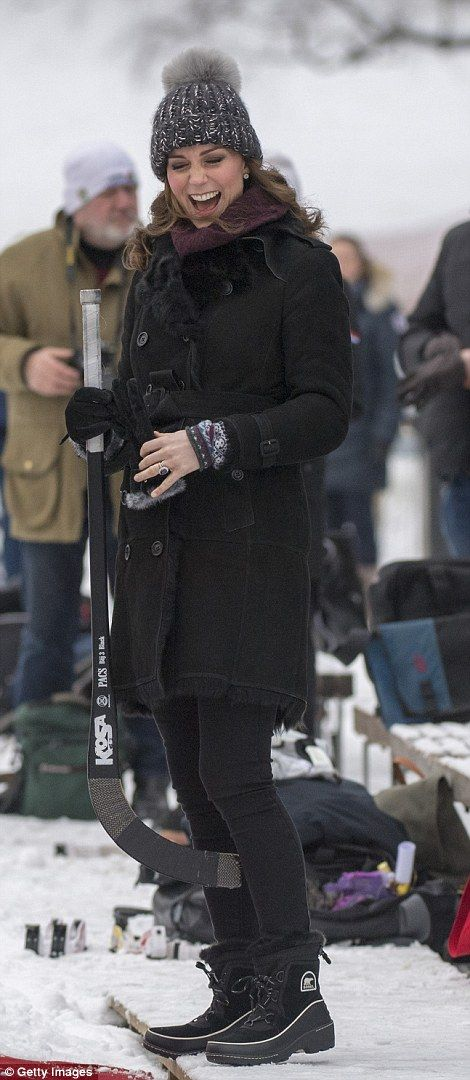 His pregnant wife looked equally cosy in a shearling Burberry coat, teamed with skinny jeans and snow boots