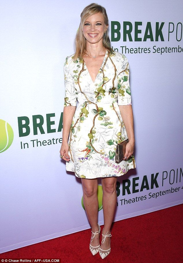 Summer style: Amy Smart appeared chic in a floral and plant-patterned white dress as she attended a special screening of Break Point at the Chinese 6 Theatres in Los Angeles, California