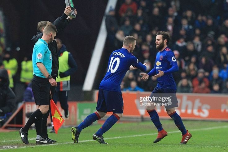 Manchester United's English striker Wayne Rooney (C) comes on to replace Manchester United's Spanish midfielder Juan Mata (R) during the English Premier League football match between Stoke City and Manchester United at the Bet365 Stadium in Stoke-on-Trent, central England on January 21, 2017. / AFP / Lindsey PARNABY / RESTRICTED TO EDITORIAL USE. No use with unauthorized audio, video, data, fixture lists, club/league logos or 'live' services. Online in-match use limited to 75 images, no…