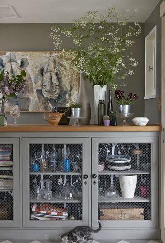 Replace door panels with chicken wire to create rustic open storage | #IKEAIDEAS