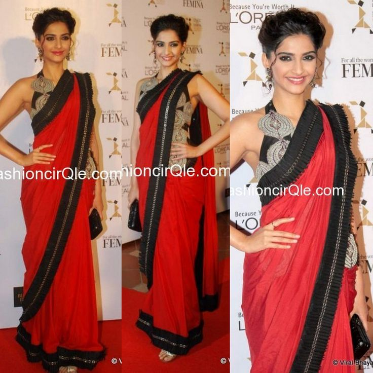 In Anamika Khanna : Sonam Kapoor : Lame or Fame? The lovely Sonam Kapoor opted for one of her favorite Indian designer, Anamika Khanna, for the L'oreal & Femina Women Awards.    Sonam sashayed down on the red carpet, wearing a Red saree with black frill detailing running all over the border. She jazzed up the look by pairing it with a black and gold full length blouse.    A chic updo and a black clutch completed her look. Lame or Fame?