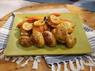 Get this all-star, easy-to-follow Sunny's Roasted Rosemary and Thyme Chicken, Carrots and Potatoes recipe from Sunny Anderson