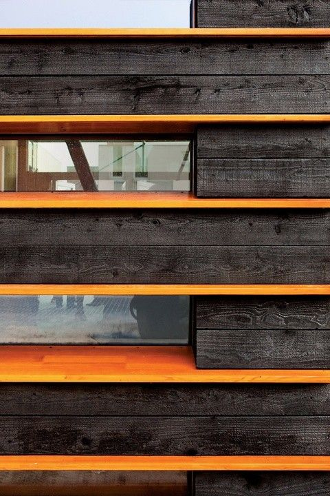 Shou sugi ban timber with bright dividers on the exterior of a residence in Amsterdam designed by architect Pieter Weijnen, who studied wood charring techniques in Naoshima, Japan. Photograph via Dwell.