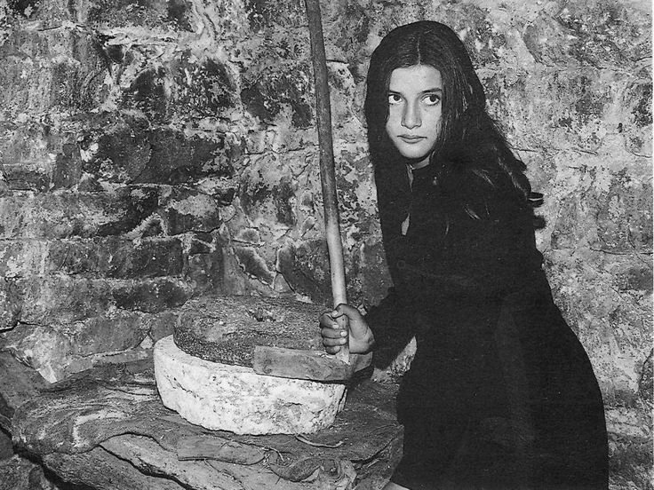 Young woman of Mani (Peloponnese) working hand mill, 1950 (Photo by Yiannis Vourlitis)