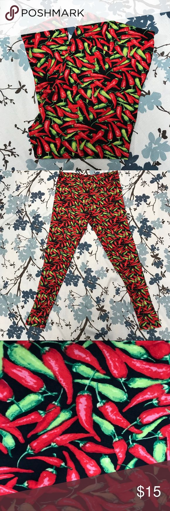 """Buttery Soft Chili Pepper Leggings size L/Xl Great condition green and red chili pepper leggings on a black background. Buttery soft same feel as LuLaRoe leggings.  Size: L/XL Measurements unstreched but they are very stretchy.  Waist: 30"""" Inseam: 27""""   Buttery soft chili pepper leggings size L/XL Pants Leggings"""