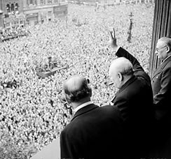 Winston Churchill waves to crowds in Whitehall, London on the day he broadcast the news that the war with Germany was over.