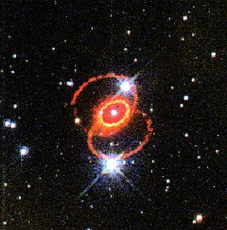 """Supernova 1987A. Taken by Hubble Space Telescope in 1995. The glowing debris of the explosion is at the center of the inner ring. The outer rings were already there at the time of the explosion, but they're visible as they reflect the light from the supernova. (Credit: George Sonneborn (Goddard Space Flight Center), Jason Pun (NOAO), the STIS Instrument Definition Team, & NASA/ESA) Mona Evans, """"Galactic Winter Games"""" http://www.bellaonline.com/articles/art182620.asp: Call Supernova, Goddard Spaces, Outer Rings, Astronom Spots, Inner Rings, Bright Spots, Exploding Stars, Doom Stars, Rings Surroundings"""