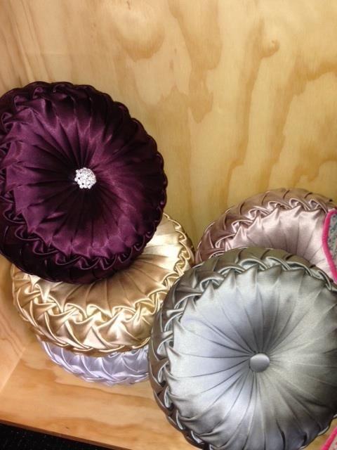 Custom made cushions made out of Designer Karen Merkels left over dress fabrics!