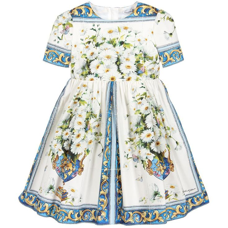 Continuing with their love affair of Italian heritage, Dolce & Gabbana have created a beautiful print of traditional Sicilian 'Caltagirone' tiles in blue and white. A grid design of flowers in vases, 'Vaso Fiori', is printed on the tiles of this delightful mini-me dress, made in cool and comfortable cotton poplin.