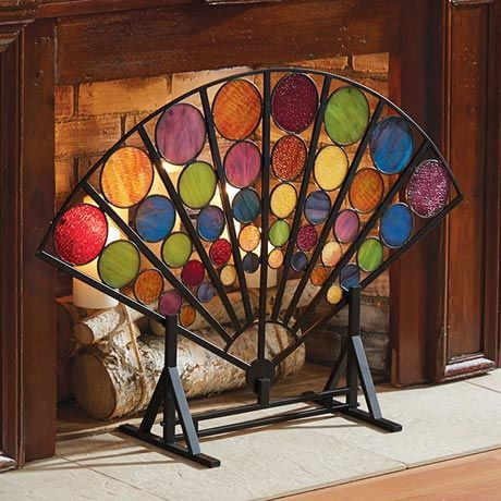Adapted from a late-19th century original, informed by the Arts and Crafts aesthetic: clean lines, quality workmanship. An iron frame and 40 art-glass circles in graduated sizes form a stylized peacock's tail. Beautiful in front of a hearth filled with candles, screen should be moved away from the heat of a log or gas fire. 40'w x 27'h x 6'd. Assembly involves attaching the 8 panels to the frame with included hardware. No rush delivery or gift box.