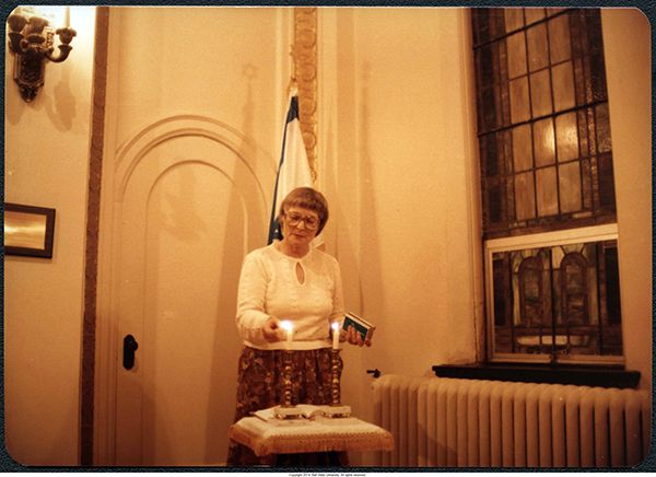 """""""Helen Schwartz lighting candles, circa 1980-1982""""  --- To learn more, visit the Temple Beth-El Records collection in the Ball State University Digital Media Repository. Copyright 2014, Ball State University. All rights reserved."""