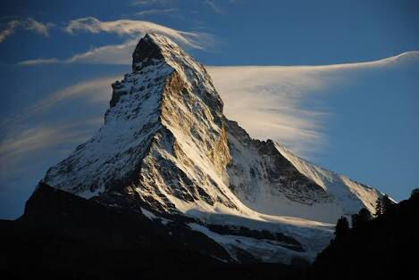The Matterhorn is mainly composed of gneisses from the Dent Blanche nappe, lying over ophiolites and sedimentary rocks of the Penninic nappes, the gneisses being originally fragments of the African Plate before the Alpine orogeny. The current shape of the mountain is the result from the cirque erosion due to multiple glaciers diverging from the peak, such as the Matterhorn Glacier at the base of the north face, forming a horn.