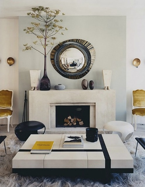Bold coffee table and fireplace in the living room of artist Herve Van der Straeten. #covetlounge @covetlounge