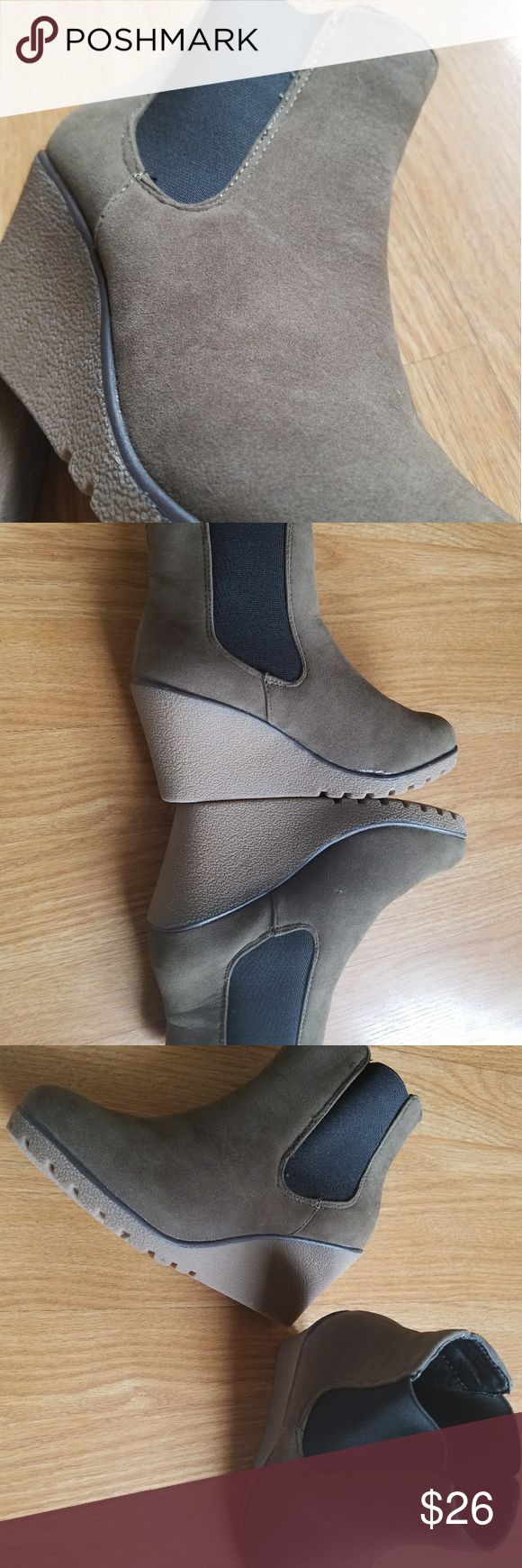 """NWOT Wedge Ankle Boots Size 6.5 Olive Green NWOT Wedge Ankle Boots Size 6.5 Olive Green , 3"""" heel, 1st Kiss brand, black elastic on sides. Without box 1st Kiss Shoes Ankle Boots & Booties"""