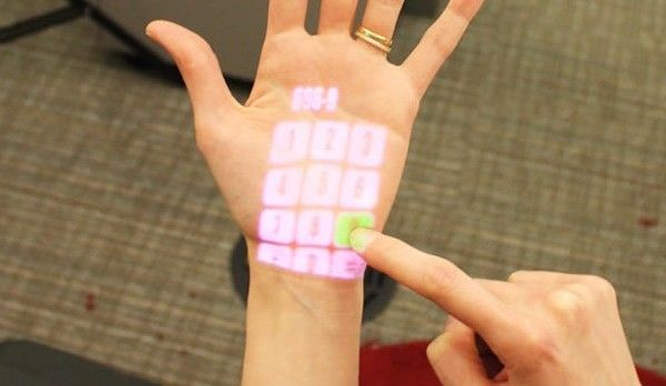 OmniTouch projection interface makes the world your touchscreen (video) -- Engadget  ... Once miniturised this maybe the future for mobile UI screens...