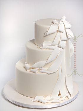 White drape wedding cake inspired by Robert Morris' felt drape installations.