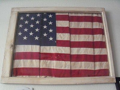 love this!  old window frame with folded flag!