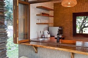 Kitchen with folding stack window opening out onto outdoor entertainment area