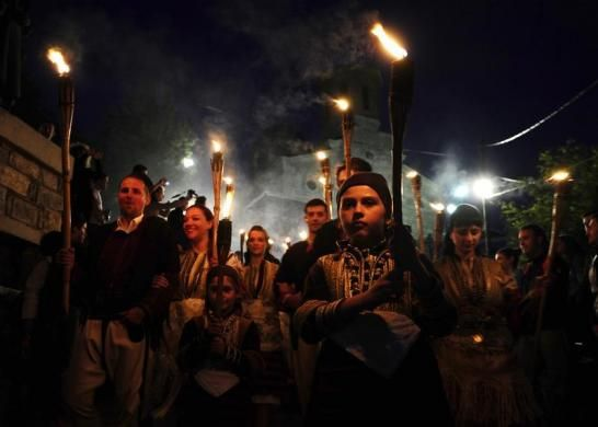 People in folk costumes hold torches as they participate in a procession the night before a wedding in Galicnik village, some 150 km (93 miles) west of Macedonia's capital Skopje July 13, 2013. The Galicnik Wedding, a three-day traditional Macedonian wedding celebration held each 'Petrovden' or St. Peter's Day for a selected couple, involves traditional customs, costumes, and rituals and dances that have been passed down over the centuries.   REUTERS-Ognen Teofilovski