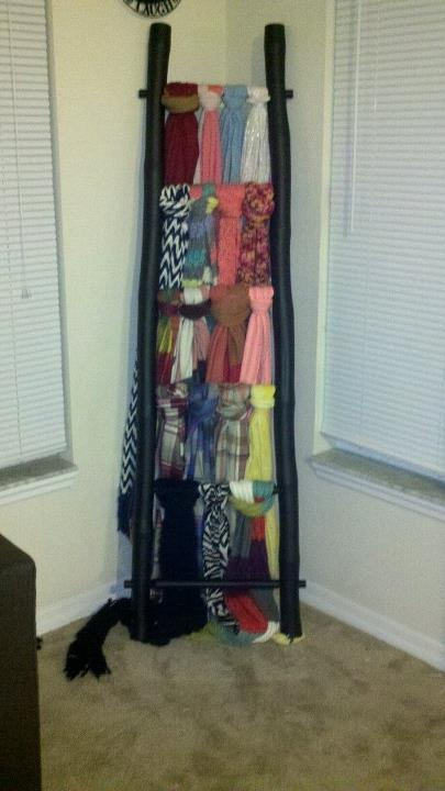 """Ladder made into a scarf holder.  [[[[Not a bad idea, again, good way to hang scarves to keep visible. Perhaps a homemade """"ladder"""" w/ more rungs?]]]]"""