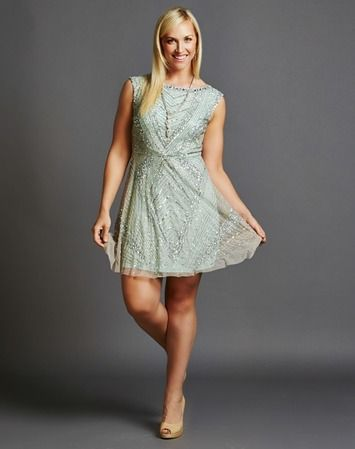What to wear: Bridesmaid - Take a spin in this beautiful sage beaded cocktail dress and transport yourself back to the 1920's. The circle skirt accentuates the waist and allows for a comfortable night of dancing. The soft sage colour is flattering on all skin tones. Delicate silver beading creates an incredible shimmer. Shop this look here: https://rentfrockrepeat.com/products/sage-beaded-cocktail-dress-with-circle-skirt