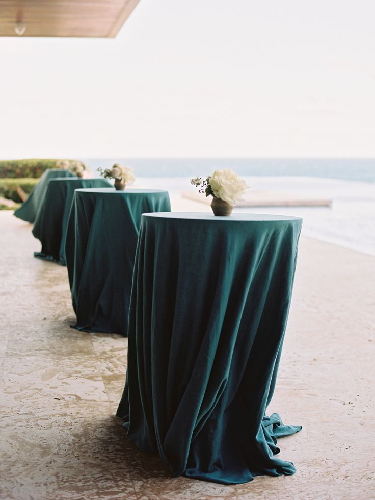 love the teal tablecloths at this reception by the sea Photography: Ryan Ray Photography - ryanrayphoto.com