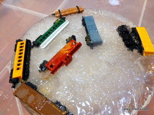 Rescuing Toy Trains from Ice:  a great activity to encourage problem solving and scientific exploration @ Play Trains! Can give them hot/cold water to see if it melts the ice as well as salt!