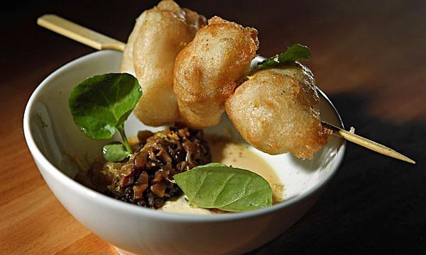 YUSHO: Japanese street food by ex-Charlie Trotter chef Matthias Merges. Bold flavors. Must-trys include: tempura-fried cod, Maitake mushrooms, Chicken thigh. Bare, raw/industrial interior. At 2853 N. Kedzie. yusho-chicago.com