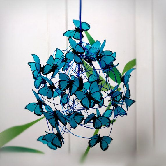 PROPERTIES: Hanging lamp made of blue cloth wrapped power cord, turquoise aluminum wire, lamp holder and ceiling rose in black color, and turquoise butterflies made of french vegetal tracing paper.  LOOK & FEEL: Our papers, imported especially from France, are 100% recyclable and chlorine free. Their colors, inspired by Murano glass, are achieved by handcrafted methods, stained from the pulp to ensure resistance over time and wear color by exposure to light. As beautiful as durable, witho...