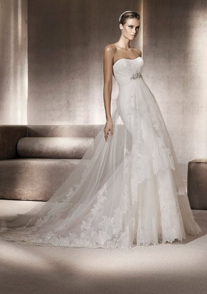 Pronovias Pompeya. Beaded, tulle and lace empire-waisted gown. I really just like the bias-cut sheer lace overlay.