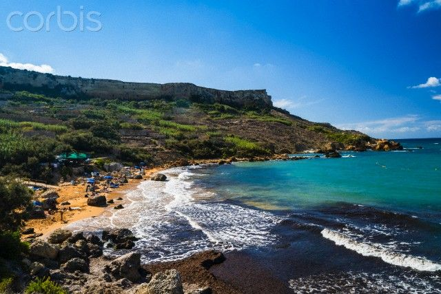 Ed Pritchard - Corbis - Distinctive ochre sand, and clear water at San Blas Bay, Gozo.