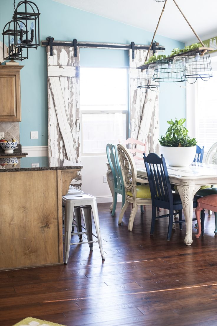 Colorful kitchen with sliding barn door | DIY Barn Door Instructions and Hardware blog post with National Hardware by All Things Thrifty