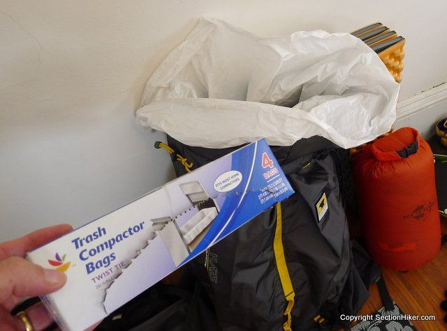 Line your Backpack with a Trash Compactor Bag - forget waterproof rain covers for your backpacks. Use this foolproof, inexpensive method to keep gear safe and dry.