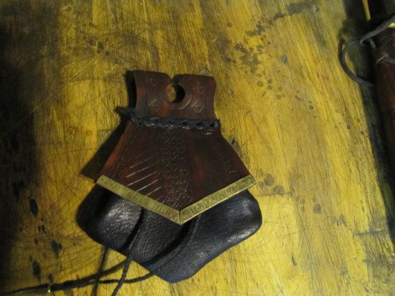 No fastener, stiff lid stays down. closes w/ drawstring.  Small brown medieval belt pouch