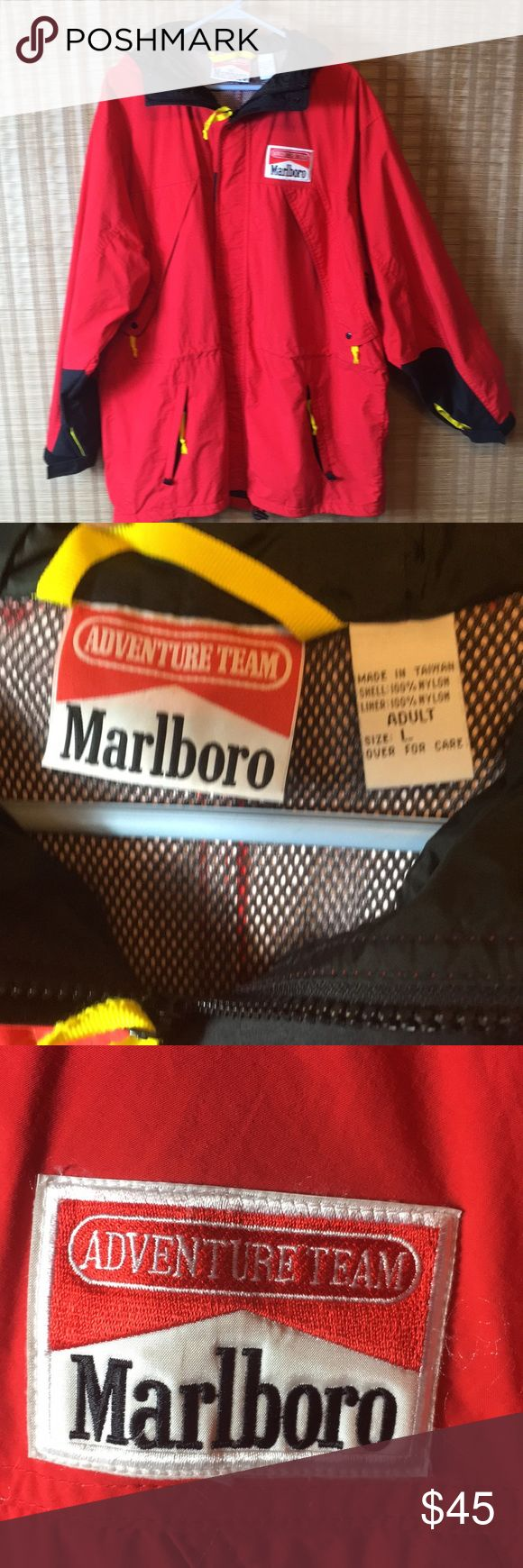 Marlboro Vintage 90's Red Windbreaker Jacket Size L x great vintage condition x zippers all work with lots of pockets x drawstring at waist x clean net lining on inside of Jacket x hood x Velcro at sleeves for adjustment x logo on front ADVENTURE TEAM x no rips but small mark on sleeve x see photo Marlboro Jackets & Coats